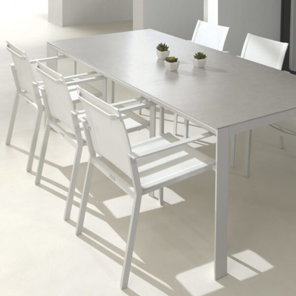 white glass aluminum outdoor table and armchairs