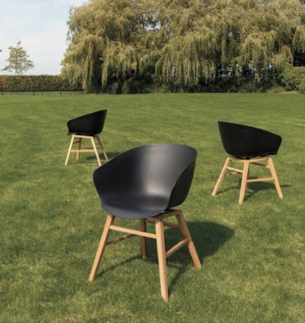 travis black pvc teak leg armchair