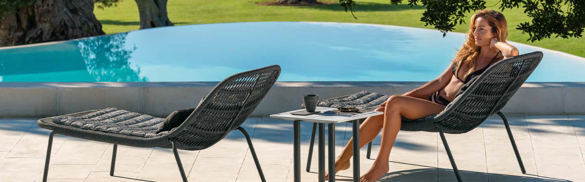 Poolside grey lounge chairs and table