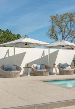 white umbrellas poolside
